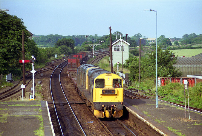 20214 and 20121 pass Barnetby on the evening of July 7th 1992 with steel empties from Grimsby.